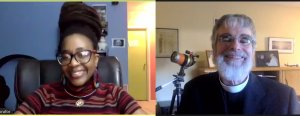 Screenshot from the virtual Holiday Lecture, with Dr. Nnedi Okorafor in the left frame, smiling, and Br. Consolmagno in the right frame, smiling